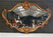 Sale 8956 - Lot 1032 - Carved and Gilt Rococo Style Oblong Framed Mirror with shell carved top and base (H:79 x W:115cm)