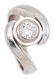 Sale 9083 - Lot 417 - AN 18CT WHITE GOLD SOLITAIRE DIAMOND RING; rub set between bypass shoulders securing the collet set with a round brilliant cut diamo...