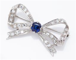 Sale 9099 - Lot 95 - A sapphire and diamond bow brooch with a central square emerald cut sapphire and twenty-four [24] single cut diamonds, set in 18ct w...