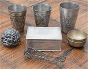 Sale 8562A - Lot 227 - A collection of EP wares including worked beakers, filigree tongs, repousse cigarette box, and carved paperweight of Jerusalem