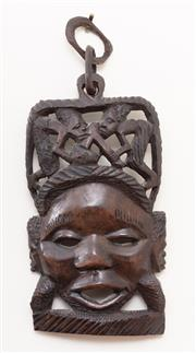 Sale 8868H - Lot 42 - An African tribal mask, carved with wood choppers, Height 38cm