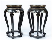 Sale 9040H - Lot 27 - A good pair of ebonised and gilded Chinese stands 76cm height