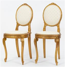 Sale 9099 - Lot 5 - A pair of French gilt painted hall chairs in the Louis XVI manner, Height of back 90cm