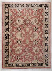 Sale 8489A - Lot 2 - A Persian woollen rug on blush pink ground with black border and repeating motif, 170 x 120cm