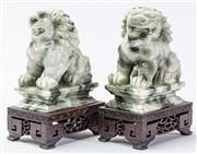 Sale 9083N - Lot 53 - A pair of jade foo dogs on timber bases. Height 15cm