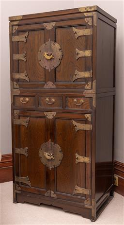 Sale 9260M - Lot 13 - A Korean two part Tansu, the upper section composing of two cupboard doors over the lower section composing of three short drawers o...