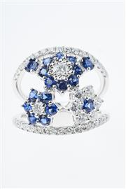 Sale 8299J - Lot 364 - AN 18CT WHITE GOLD SAPPHIRE AND DIAMOND RING; centring three floral clusters of round cut blue sapphires and round brilliant cut dia...