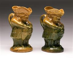 Sale 9098 - Lot 81 - A Pair of 19th Century Glazed Earthenware Toby Jugs, cracked and repaired , H: 22.5cm