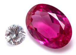 Sale 9156J - Lot 529 - TWO UNSET SYNTHEYTIC STONES; a 40.87ct oval ruby, 24.9 x 18mm and a 10mm round cut zirconia.