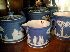 Sale 7383 - Lot 18 - Four pieces of blue and white Wedgwood Jasperware comprising teapot, sugar bowl, creamer and beaker
