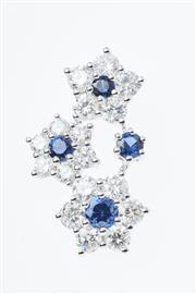 Sale 8322J - Lot 400 - AN 18CT WHITE GOLD DIAMOND AND SAPPHIRE PENDANT; three floral clusters set with round cut blue sapphires and 17 round brilliant cut...