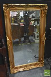 Sale 8312 - Lot 1012 - Ornate Gilt Framed Bevelled Edge Mirror (142 x 81cm)