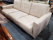 Sale 8688 - Lot 1035 - Leather Upholstered Three-Seater Sofa