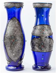 Sale 9083N - Lot 24 - A large and decorative pair of blue glass vases inset with silver and stone cabochons. Height 54cm