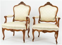 Sale 9099 - Lot 21 - A pair of French walnut armchairs in the Louis XV manner. Height of back 45cm x Width 65cm