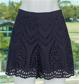 Sale 9120K - Lot 66 - A pair of Zimmermann navy harlequin broderie flare shorts; as new with original tags, RRP $295.00, size UK 8
