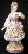 Sale 7746 - Lot 51 - Paris Porcelain Figure of a Young Maiden in Traditional Dress