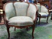 Sale 8539 - Lot 1038 - Pair of Louis XV Style Carved Walnut Tub Chairs, upholstered in aqua fabric with silver foliage design