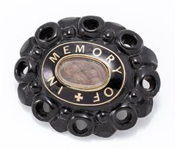 Sale 9180E - Lot 26 - A Victorian jet mourning brooch with hair compartment to centre, length 5.5cm
