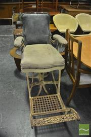 Sale 8350 - Lot 1100 - Iron Based Vintage Barbers Chair, marked army navy to footrest