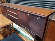 Sale 8705 - Lot 1082 - Danish Rosewood Sideboard with Three Central Drawers and Drop Front Compartment