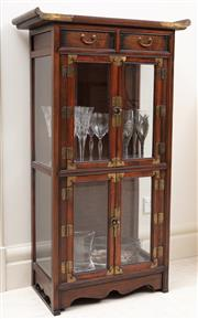 Sale 8868H - Lot 59 - A Korean elm display cabinet with two bevelled edge glass doors and two drawers with brass embellishment, Height 112cm, Width 65cm, ...