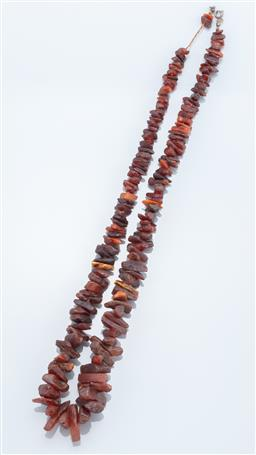Sale 9149 - Lot 318 - A GRADUATED DARK AMBER BEAD NECKLACE; 8 - 26mm amber shards, length 68cm.