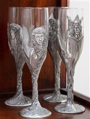 Sale 8868H - Lot 60 - Four pewter Lord of the rings champagne flutes, signed 1996 WDL to base, Height 22cm