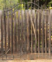Sale 8871H - Lot 55 - A pair of metal gates of arch form, height 213 x 152cm