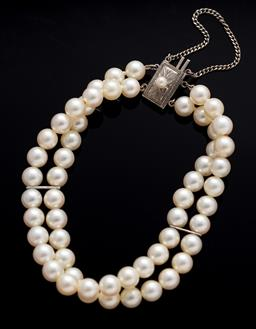 Sale 9099 - Lot 143 - A Mikimoto 6.0-6.Smm round Akoya cultured pearl two row bracelet with a silver clasp
