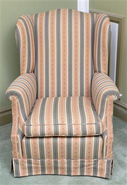 Sale 9190H - Lot 350 - An Edwardian wing back striped fabric arm chair C: 1905, upholstered in multi toned blue striped fabric. The base of the arm chair s...
