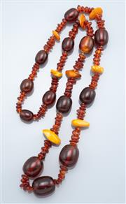 Sale 9037F - Lot 60 - A GRADUATED MIXED AMBER BEAD NECKLACE;  17-26mm dark oval beads and 14-25mm freeform butterscotch amber beads between 8-14mm freefor...
