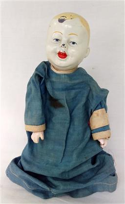 Sale 9142A - Lot 5103 - Early American Squeeze Doll: tin head and hands with cotton dress, h.22cm