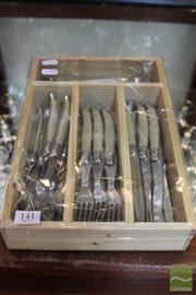Sale 8217 - Lot 141 - Laguiole by Louis Thiers Cutlery Set of 24 w Bone Style Handles