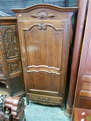 Sale 8634 - Lot 1093 - French Oak Bonnitiere, with arched cornice, shaped panel door & carved drawer below