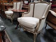 Sale 8868 - Lot 1035 - Pair of Louis XV Style Carved & Painted Armchairs, in cream and old gold, upholstered in cream linen & raised on cabriole legs