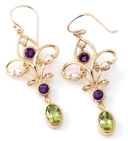 Sale 9140 - Lot 359 - A PAIR OF NOUVEAU STYLE SUFFRAGETTE COLOURED GEMSET EARRINGS; 9ct gold scrolling frames each set with seed pearls and round cut amet...