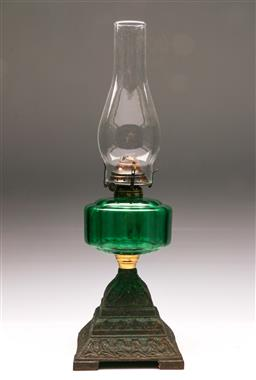 Sale 9136 - Lot 299 - Cast iron based kerosene lamp with green glass midsection (H:53cm)