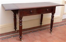 Sale 9190H - Lot 246 - An Australian Colonial cedar drop side full width apron drawer side table C: 1880, raised on tapering turned legs with brass and por...