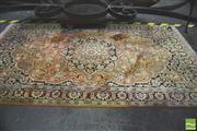Sale 8291 - Lot 1038 - Kashmir Silk Rug with black medallion on salmon field (154 x 95cm)
