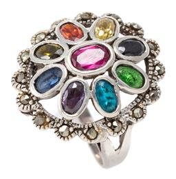 Sale 9164J - Lot 326 - A SILVER GEMSET COCKTAIL RING; centring a synthetic ruby surrounded by oval cut blue topaz, citrine, garnet amethyst, blue sapphire,...