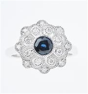 Sale 8373J - Lot 355 - AN 18CT WHITE GOLD SAPPHIRE AND DIAMOND CLUSTER RING; centring a round cut dark blue sapphire surrounded by 16 round brilliant cut d...
