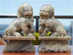 Sale 9099 - Lot 241 - A Pair of greenstone fo dog book ends. Height 20cm