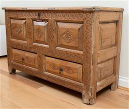 Sale 9165H - Lot 22 - An 18th Century pine mule chest carved with panelled and floral decoration with two lower drawers. (some losses) Height 75cm x Width...