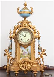 Sale 9070H - Lot 84 - A magnificent French mantle clock with painted porcelain panel and supports with cherubs and medusa head beneath a baby blue finial,...