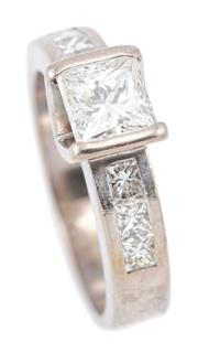 Sale 9083 - Lot 427 - AN 18CT WHITE GOLD PRINCESS CUT DIAMOND RING; part rub set with a princess cut diamond of approx. 1.01ct, SI2, to shoulders each set...
