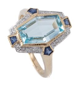 Sale 9149 - Lot 433 - A DECO STYLE 9CT GOLD GEMSET RING; long hexagonal shape top centring a blue topaz, 4 mixed cut blue sapphires and 8 round brilliant...